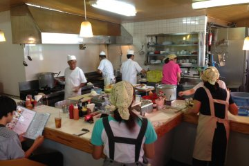 <p>The interior isn&#39;t grandly decorated but its fun to watch the employees shuffle about the kitchen and dining area to feed the usually packed restaurant of customers</p>