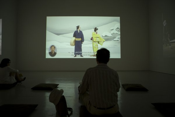 A gallery patron views one of the films on display