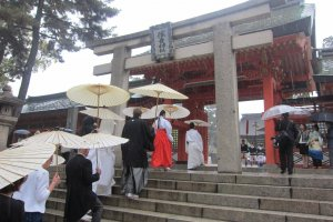 A wedding procession entering the central courtyard