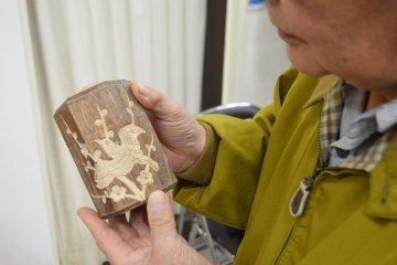 A local craftsman admires his work