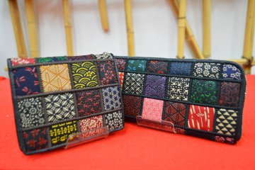 Wallets created using a patchwork of traditional Japanese motifs patterned in inden (lacquered deerskin leatherwork)
