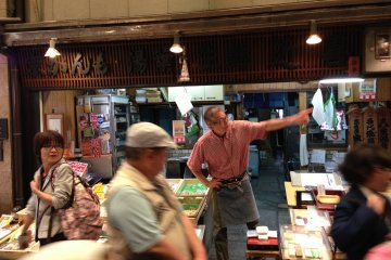 The 4th generation owner of this tofu shop is in his element at Nishiki Food Markets in Central Kyoto
