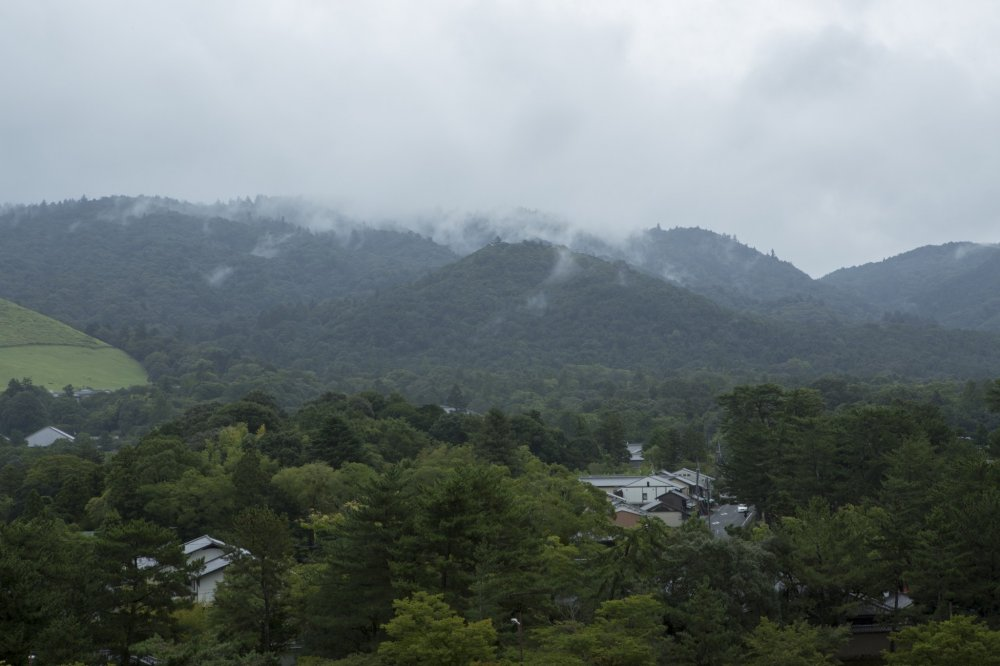 Mist rolls down the mountains towards the city of Nara