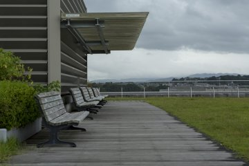 Benches can be enjoyed on a sunnier day but the rain isn't enough to ruin such a view