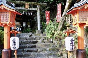 A historic shrine looks down on the hotel garden.
