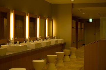 The changing room of the women's spa area is very sleek and modern