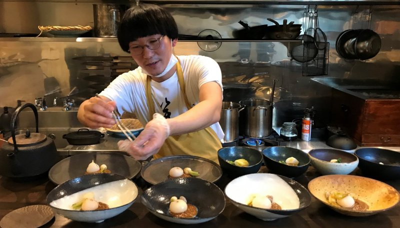 The restaurant owner and chef, Mr. Mikio Sugata, in action.