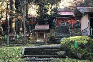 Some steps lead to a shrine building