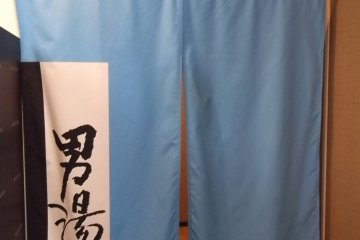 A blue curtain for the mens' spa