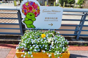 Many Garden Necklace flower boxes with directions to the parks