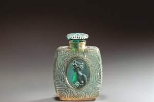 A perfume bottle decorated with fern leaf designs