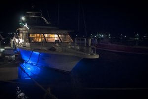 The night-cruising boat glows with blue LEDs underneath