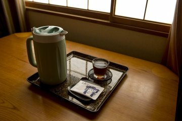 Each morning and night you get a complimentary Thermos flask filled with ice cold Mugicha (barley tea) placed in your room. In the mornings you also get a small Bunraku themed biscuit too