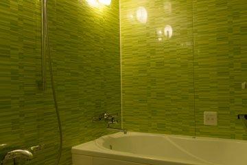 <p>A modern bathroom with a Jacuzzi style bath tub</p>