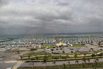 <p>The Ginowan City Marina and the China Sea can be seen across the Route 58 bypass from Round 1</p>