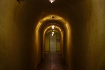 Walk through this eery tunnel to enter your room.