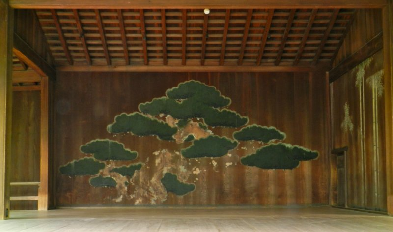 Painting of a pine tree on one of the buildings.