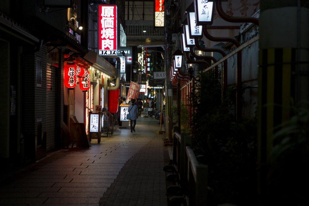 The streets of Hozenji Yokocho soon fades off into the modern metropolis of Osaka