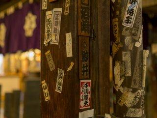 Religious seals line the beams of the Hozenji Yokocho temple between Dotonbori and Nanba