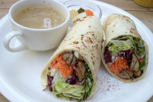 Veggie wrap with soup and pickles