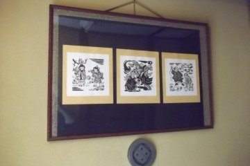 <p>The walls are adorned with old prints like this</p>