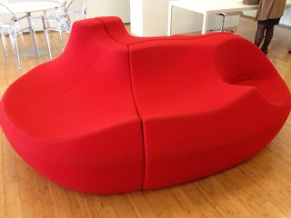 An odd spaced seating chair, something you don't see everyday.