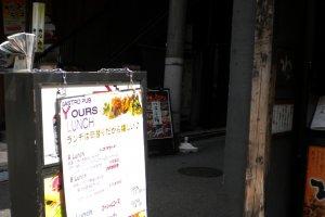 "The entrance to ""Trattoria Yours"" near JR Yokohama Station"