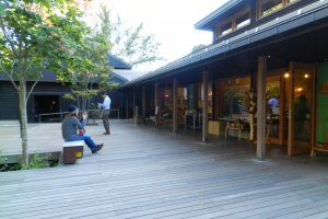 The wooden terrace is lined with shops.