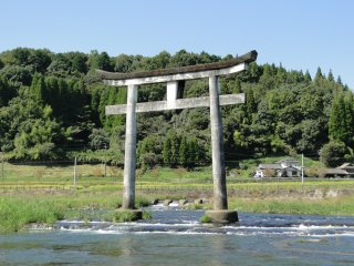 A torii gate just upstream from the falls
