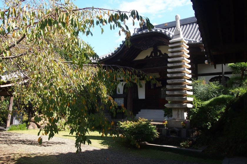 The shrine compound is decorated with a little landscape garden in the middle and little pebble stones.
