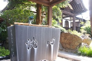 """The Japanese kanji engraved on the trough, """"sen shin,"""" means to wash or purify one's heart."""