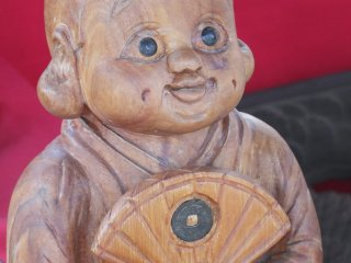 A wooden carving for sale
