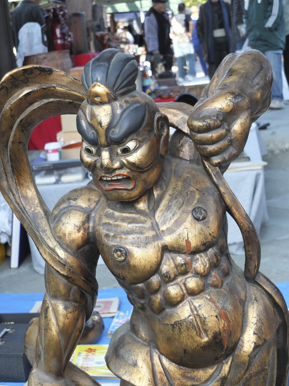 A beautiful wooden carving of a god in gold