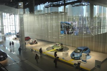 The gallery displays almost 30 kinds of cars in its beautiful, spacious glass showroom. When you find a car you like, climb into the driver's seat and grab the steering wheel.
