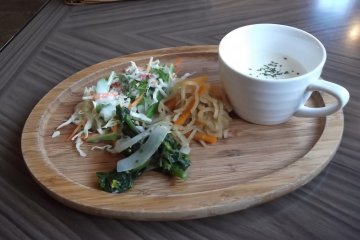 <p>My soup and salad on their wooden platter</p>