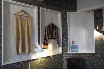 <p>Fashion and stuff adorning the walls</p>