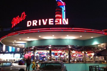 Enjoy burgers & fries at Mel's Drive-In Diner, the first carhop eatery in San Francisco, CA