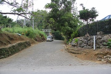 <p>The entrance to the Chibana Castle Site is at the end of this steeply inclining road</p>