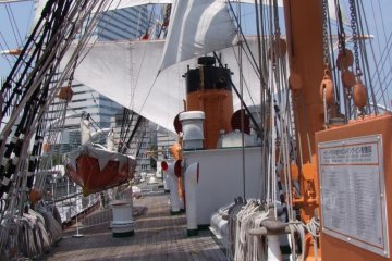 The ship itself is gorgeous, with big white sails, wooden decks that shine with polish, and ropes and knots and other ship stuff that is very impressive.