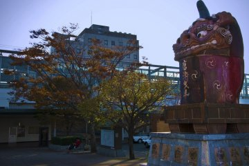 Statue of Akajishi or the red lion at the JR Karatsu station north exit