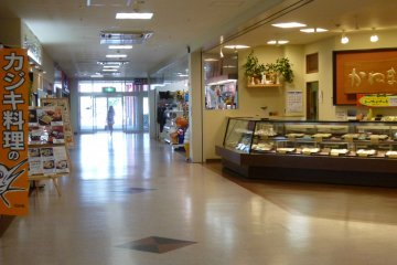 The first floor is lined with restaurants and shops.