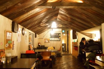 The cosy interior of the top level of the restaurant that looks like a little hut.