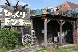 Bikkuri Donkey's Chatan location is decorated with faded wood and old aluminum siding