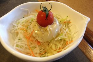 A side cabbage and lettuce salad
