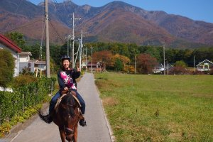 On horseback against the backdrop of Mount Yatsugatake.