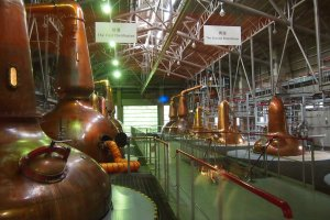 Distillation is done in big copper tanks.