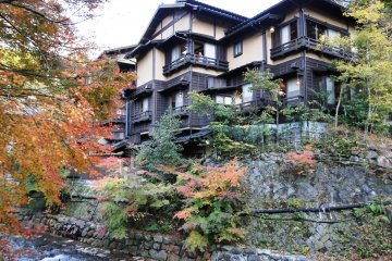A ryokan against a backdrop of changing maples
