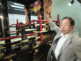 """Mr. Sunao Tsuchida, director of Echizen Lacquer Ware Cooperative Association, explaining some of the hundreds of the unique details of this """"Dashi"""""""