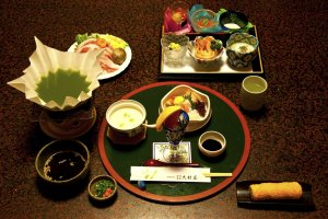 Multi-course Japanese dinner; here we have the appetizers and the green tea, the pork and vegetables needed to prepare the cha-shabu—delicious!