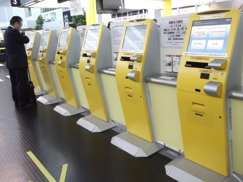 <p>Self check-in machines at Kobe Airport</p>